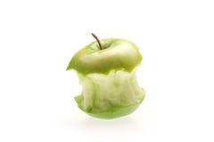 Manzana verde con la mordedura Imágenes de archivo libres de regalías
