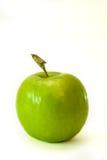 Manzana verde con una cola Imagenes de archivo