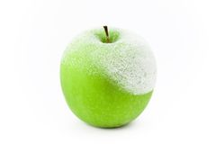 Manzana verde congelada Imagen de archivo libre de regalías