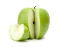 Manzana verde cortada Imagen de archivo libre de regalías