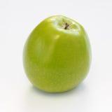 Manzana verde en el fondo blanco Imagen de archivo