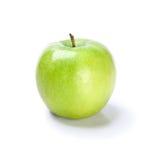 Manzana verde en el fondo blanco imagen de archivo libre de regalías