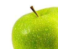 Manzana verde en un fondo blanco. Imagen de archivo libre de regalías