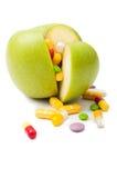 Manzana verde llenada de concepto de las drogas Imágenes de archivo libres de regalías