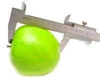 Manzana verde medida Imagen de archivo