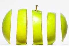Manzana verde rebanada Imagenes de archivo