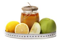 Manzana y contador del limón de la miel Foto de archivo