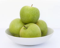 Manzanas. Four organic and natural Granny Smith apples Stock Photos
