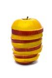 Manzanas amarillas y rojas rebanadas Foto de archivo