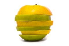 Manzanas amarillas y verdes rebanadas Imágenes de archivo libres de regalías