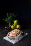 Manzanas cocidas con las nueces y el merengue Imagen de archivo