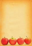 Manzanas contra el papel viejo Imagen de archivo libre de regalías