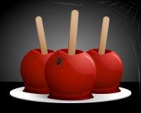 Manzanas de caramelo de Víspera de Todos los Santos Fotografía de archivo libre de regalías