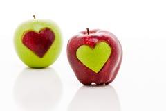 Manzanas del corazón Imagenes de archivo