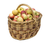 Manzanas en cesta tejida Foto de archivo libre de regalías
