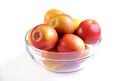 Manzanas en tazón de fuente Fotografía de archivo libre de regalías