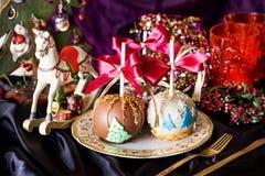 Manzanas en un palillo en el Año Nuevo Imagen de archivo libre de regalías