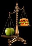 Manzanas en vez de las hamburguesas Imagen de archivo