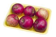 Manzanas feas rojas baratas fotos de archivo