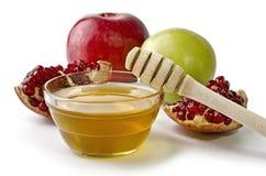 Manzanas, granada y cuenco de miel Fotos de archivo
