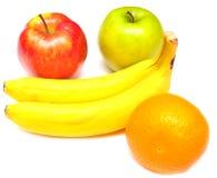 Manzanas, plátano y naranja jugosos Fotografía de archivo libre de regalías
