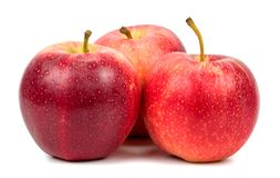 Manzanas rojas en un fondo blanco Fotografía de archivo libre de regalías