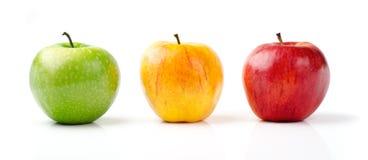 Manzanas verdes, amarillas y rojas Imagenes de archivo