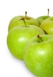 Manzanas verdes en blanco Imagen de archivo libre de regalías