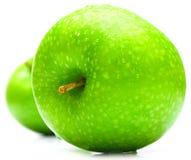 Manzanas verdes mojadas Imágenes de archivo libres de regalías