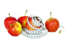 Manzanas y medida fotografía de archivo