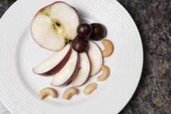 Manzanas y tuercas Foto de archivo libre de regalías