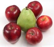 Manzanas y una pera Imágenes de archivo libres de regalías