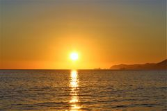 Manzanillo Beach sunset horizon. An orange sunset at Manzanillo Beach on Mexico`s Pacific coast Stock Photos