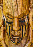 Maori Ancestral Board. Detail of wooden carved maori plate. North Island, New Zealand stock photo
