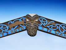 Maori Art. Maori carving - face carved in the wood. Rotorua, New Zealand royalty free stock photos