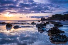 Maori Bay en la puesta del sol Foto de archivo libre de regalías