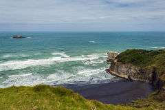Maori Bay - Muriwai Beach Auckland New Zealand. Favorite place for surfing and paragliding Stock Photography