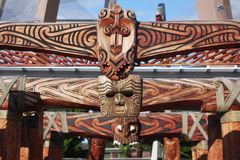 Maori Carved Gate. Gate of a geothermal park with Maori wooden carvings, in Rotorua, New Zealand stock image