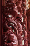 Maori carving. Detail of carved Maori totems stock photo