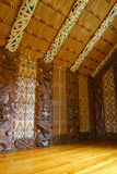 Maori Carvings. Maori wall carvings in a Marae (meeting house stock image