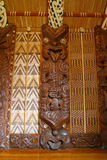Maori Carvings. Maori wall carvings in a Marae (meeting house royalty free stock photos