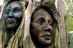 Maori carvings. Of a man and a woman's face - New Zealand stock image