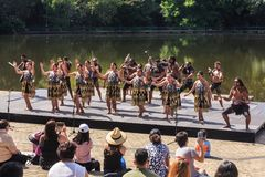 Maori dancers in traditional costume, Hamilton, New Zealand. Male and female Maori performers in traditional kapa haka costumes at Hamilton Gardens. The fierce stock photography