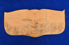 Maori man face wood carving sculpture Royalty Free Stock Images