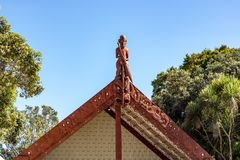 Maori Marae village building On Waitangi day. Feb 6th in New Zealand remembers waitangi day, the signing of the peace treaty between english settlers and maori royalty free stock photo