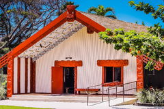 A Maori Meeting House. Honolulu, Hawaii - May 27, 2016: A Maori Meeting House in the Aotearoa Village at the Polynesian Cultural Center, a popular tourist Stock Image