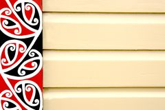Maori patterned frieze on wooden building. Royalty Free Stock Photo