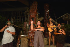 Maori people sing and dance. Maori are the indigenous people of New Zealand that migrated to New Zealand from Polynesia1000 years ago royalty free stock photo
