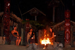 Maori people women sit around bonfire. Maori are the indigenous people of New Zealand that migrated to New Zealand from Polynesia1000 years ago stock photos