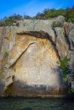 Maori rock carvings, Taupo Lake, New Zealand. Traditional Maori rock carvings, Taupo Lake, New Zealand Royalty Free Stock Photography